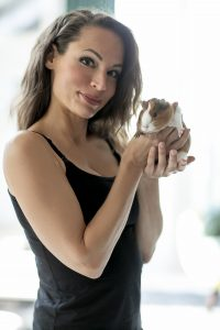 Betti of Inspaw with a guinea pig in her hands